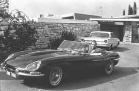 CHUCK DRIVING AWAY FROM HIS HOME'S FRONT DOOR IN HIS JAGUAR-'67