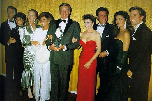 CAST OF THE COLBYS RECIEVING AWARD('85)